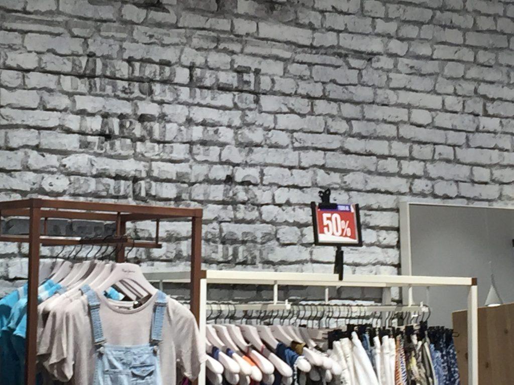 Paneles de ladrillo en una tienda de moda - Paneles de ladrillo ...